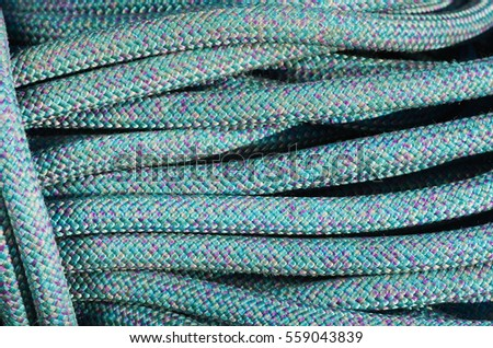 coiled up blue rock climbing rope background