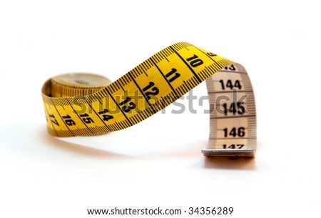 Coiled yellow Tape Measure isolated