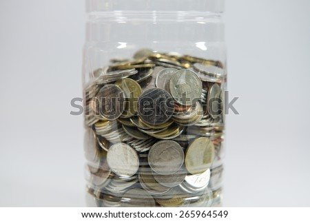coilns money in the bottle isolate on white background - stock photo