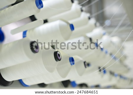 Coils synthetic thread. Spools of thread.