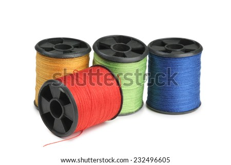 Coils with multi-colored threads on a white background