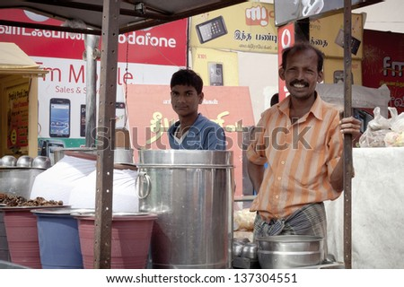 "COIMBATORE, INDIA - JANUARY 16: Locals sell ""cooly"" - indian popular street food,  January 16, 2013 in Coimbatore, Tamil Nadu, India. a - stock photo"