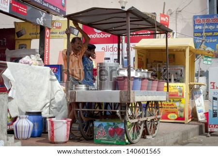 "COIMBATORE, INDIA - JANUARY 16: Locals sells ""cooly"" - indian popular street food,  January 16, 2013 in Coimbatore, Tamil Nadu, India. a - stock photo"