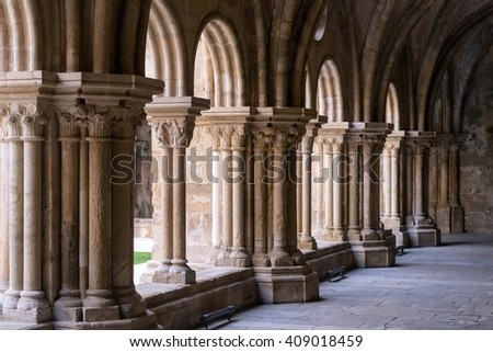COIMBRA, PORTUGAL - FEBRUARY 07, 2016: The cloister of the Old Cathedral of Coimbra is a Romanesque Roman Catholic building in Portugal.