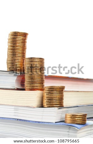Coin and book - stock photo