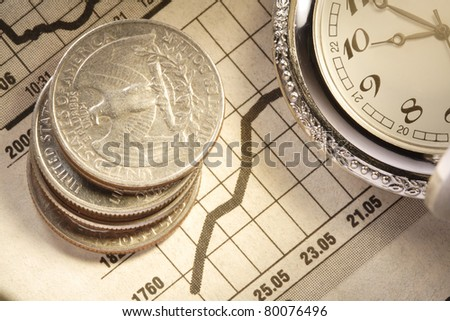 coin and clock on chart - stock photo