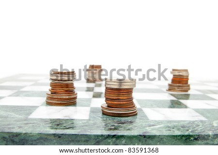 coin chess pieces on the board, on white - stock photo