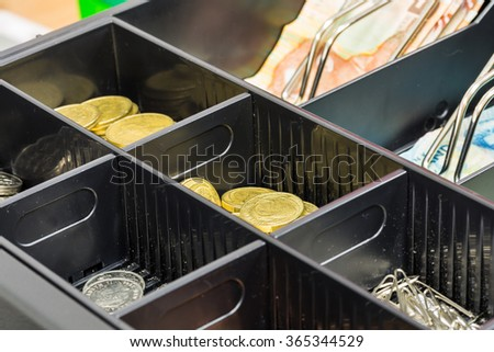 coin in cash register - stock photo