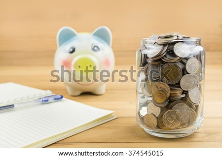coin in glass bottle,saving money concept,selective focus - stock photo