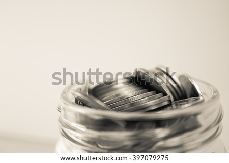 coin money in the glass bottle for savings money concept - stock photo