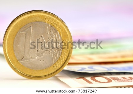 Coin of amount one eur standing on its edge