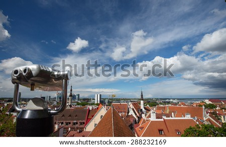 Coin Operated Binocular viewer in travel over city skyline on blue sky and beautiful clouds background - stock photo