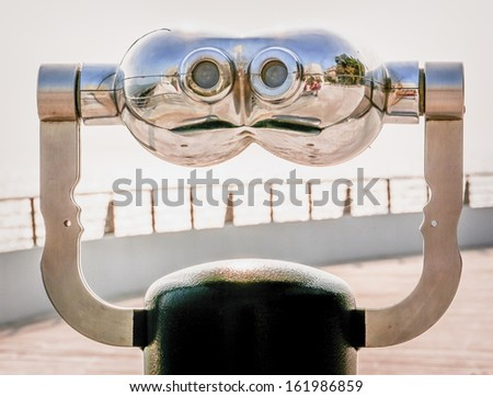 coin operated binoculars at a observation point - stock photo