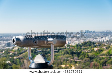 coin operated binoculars in front of Los Angeles' skyline