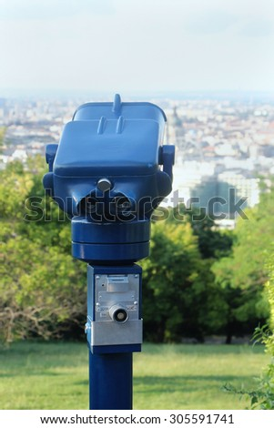 Coin operated binoculars viewer machine for tourists to look at architecture and landmarks