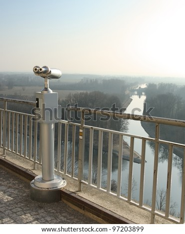 Coin operated telescope looking out Canal Vltava - Labe in Melnik, Czech Republic - stock photo