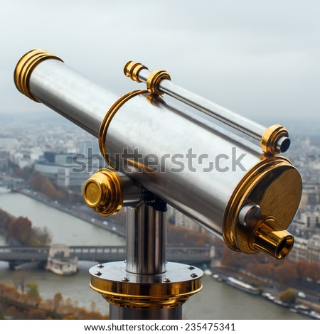 Coin operated telescope on the Eiffel Tower in Paris. Pay per view concept - stock photo