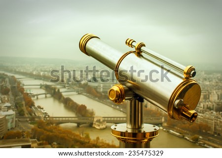 Coin operated telescope on the Eiffel Tower in Paris. Toned image - stock photo