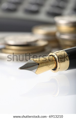 coin, pen and calculator