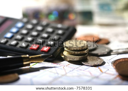 coin, pen, calculator and london underground map - stock photo