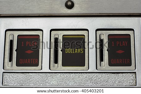 Coin Slots of a Pinball Machine - stock photo