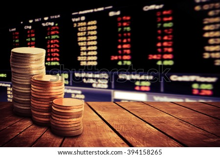 coin stack on old wooden floor with blur perspective stock market number background - stock photo
