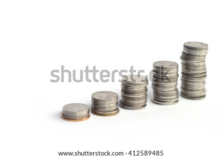Coin stacks on a white background, Selective focus.