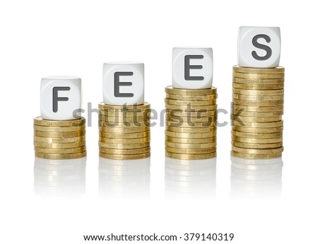 Coin stacks with letter dice - Fees - stock photo