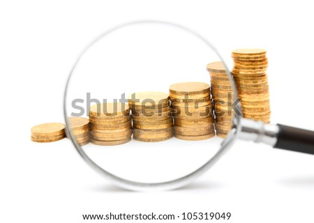 Coins and a magnifier. On a white background. - stock photo