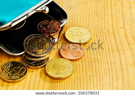 coins and an empty wallet with a few �¢â���¬. photo icon on debt and poverty - stock photo