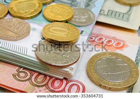 Coins and banknotes of different countries, close up.