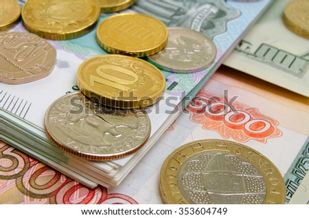 Coins and banknotes of different countries on the plane.