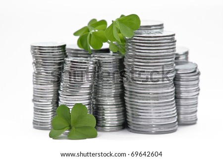 Coins and clover - stock photo