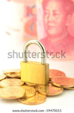Coins and lock isolated on 100 RMB background - stock photo