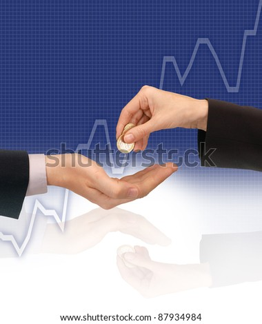 coins being exchanged against a graph showing increasing share price - stock photo