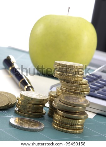 Coins, calculations and apple - stock photo