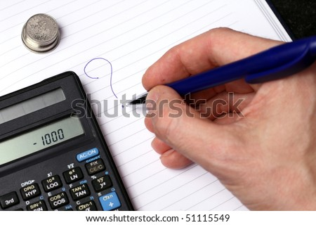 Coins, calculator, hand writing on white striped paper with blue pen - stock photo