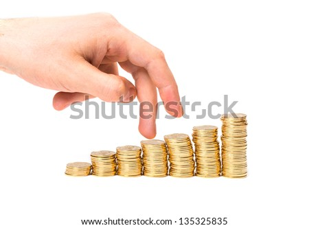 Coins column and fingers on white - stock photo