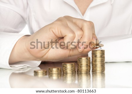 coins diagram with hand and reflection - stock photo