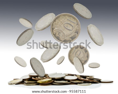 Coins falling and pile of coins - stock photo