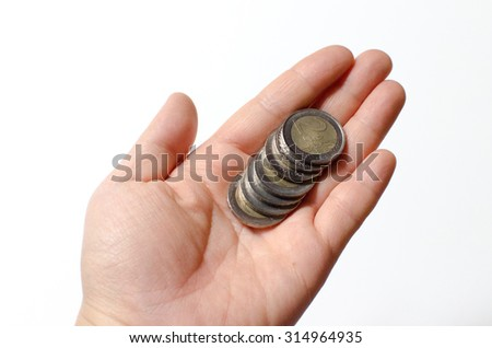 Coins falling down from a hand - stock photo