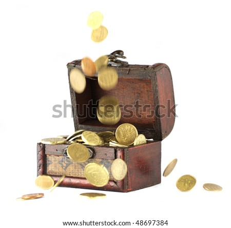 Coins falling down into the wooden casket - stock photo