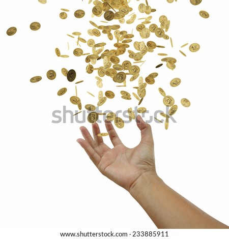Coins falling down to the business's hand - stock photo