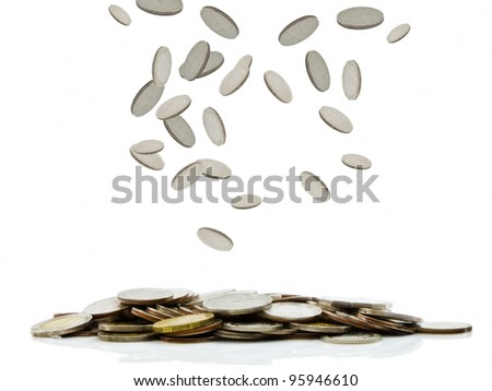 Coins falling down to the pile