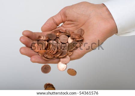 Coins falling from a hand - stock photo