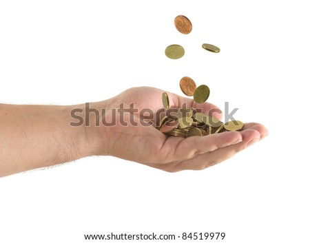 coins falling in a hand in a white background - stock photo
