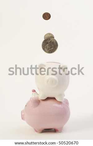 coins falling in piggy bank - stock photo