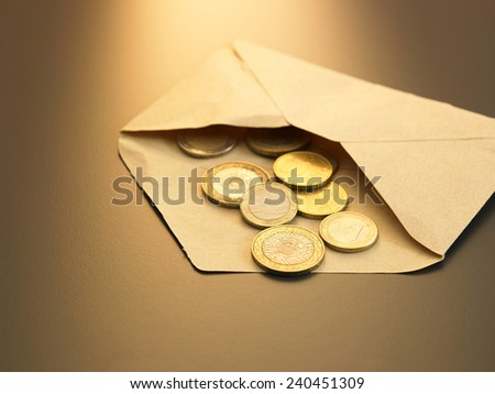 coins from the brown envelope - stock photo
