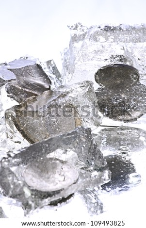 Coins frozen on Reflective Background - stock photo