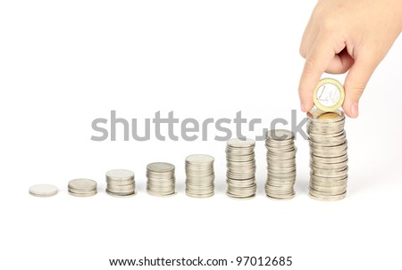 Coins graph with hand keep euro coin - stock photo